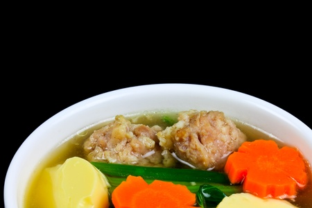 Tofu soup with vegetables and pork photo