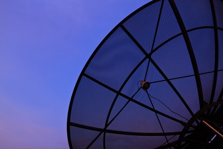 Satellite dish closeup with evening sky background  photo