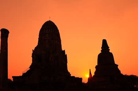 Silhouetted of pagoda with evening light photo