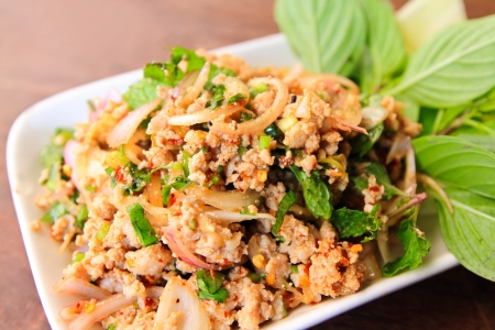 Thai cuisine   Spicy minced meat salad photo