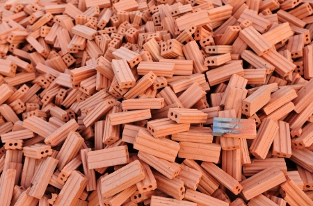 Pile of bricks for construction work photo