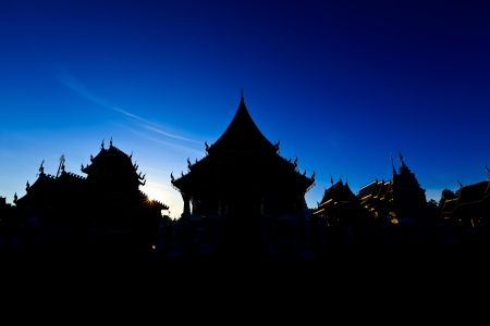 Silhouette of temple with sunset at chiangmai, thailand