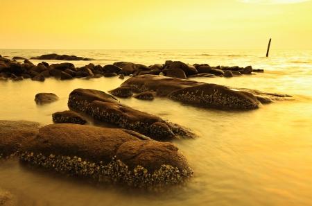 Sunset beach and rocks Stock Photo - 24688787