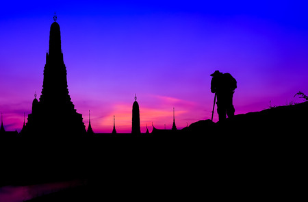 silhouetted: Silhouetted of photographer and pagoda in dusk