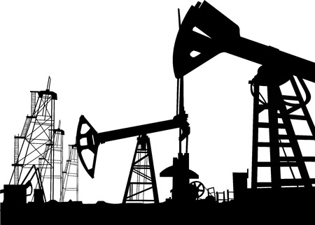 Silhouetted of oil derrick in field