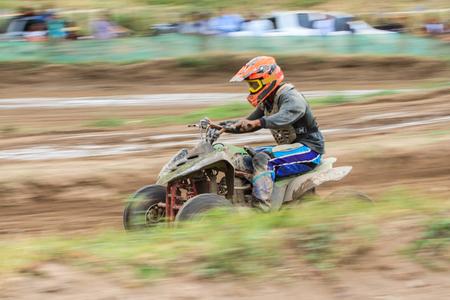 quad: Motion blurred of quad bike in dirt track