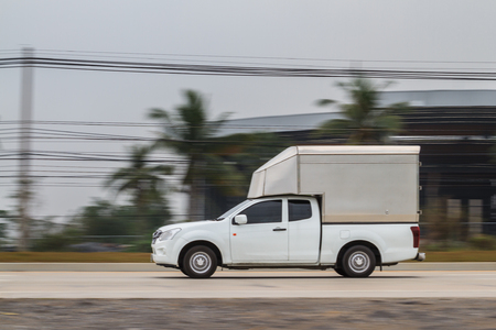 White truck moving at high speed with blurred background Stock Photo