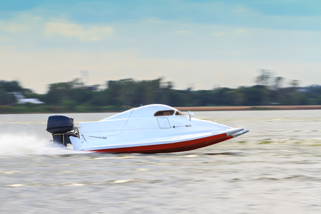 Formula 5 boat go fast along the lake in Powerboat competition