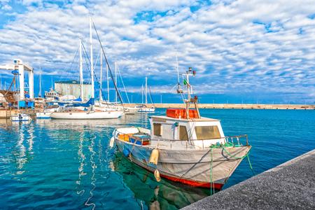 Boat moored at Monopoli port - Italy, Puglia. Adriatic sea Stock fotó