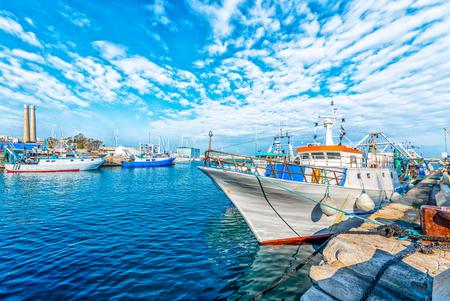 Boat moored at Monopoli port - Italy, Puglia. Adriatic sea Stock Photo