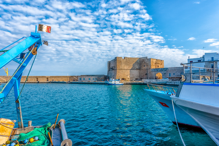 Boats harbour at Monopoli old port with the Castle of Carlo V in the background