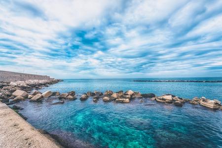 View of the Adriatic Sea. Beautiful seascape with stones, Bari, Puglia, South Italy