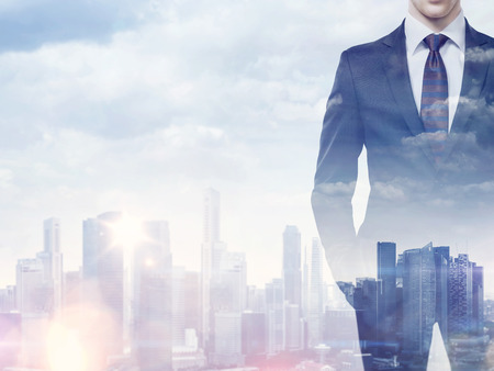 leadership: Double exposure of businessman and city