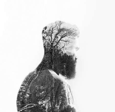 arte abstracto: Doble exposici�n de un hombre con barba y el �rbol Foto de archivo