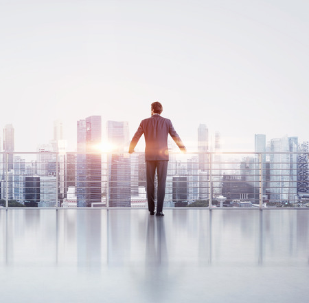 horizons: Businessman standing on a roof