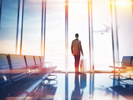 starting a business: Businessman at airport Stock Photo