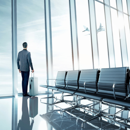 starting a business: Business man at airport