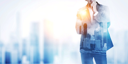 expert: Double exposure of city and business man Stock Photo