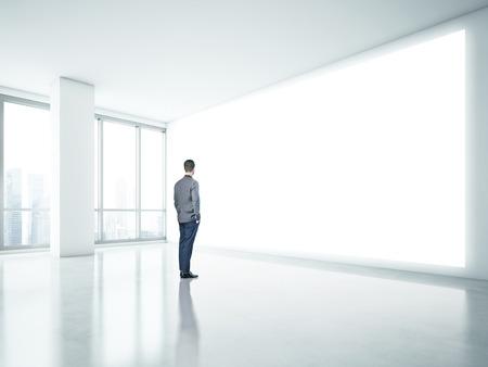 Man looking at white panel photo