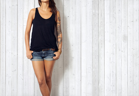 Woman wearing blank sleeveless t-shirt Standard-Bild