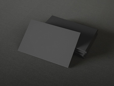 Black business cards on textile background