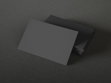 Black business cards op textiel achtergrond Stockfoto