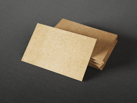 Cardboard business cards on dark background