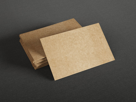 mock up: Cardboard business cards on dark background