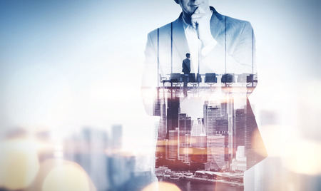Double exposure concept with thinking businessman and city