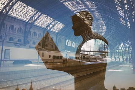 Double exposure of man with laptop on the station
