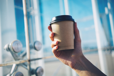 mock up of cup of coffee in hand