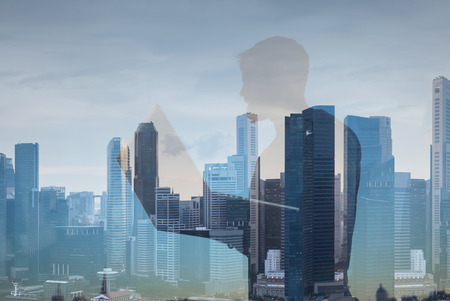 lap top: Double exposure of man with lap top on city background
