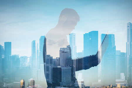 lap top: Double exposure of man with lap top on the blure city background Stock Photo