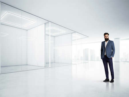 gray texture background: Blank office interior with big windows and young bussines man