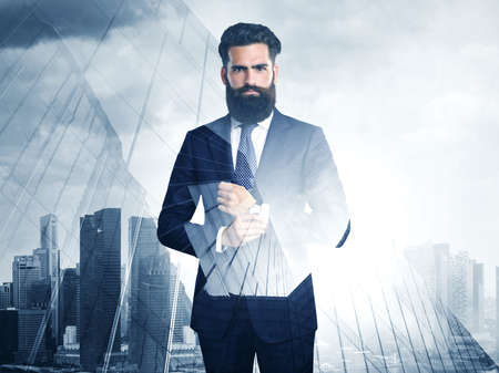 megalopolis: Double exposure of businessmen and skyscraper on megalopolis background