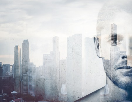 Double exposure Close-up portrait of a young attractive man and the city on the background