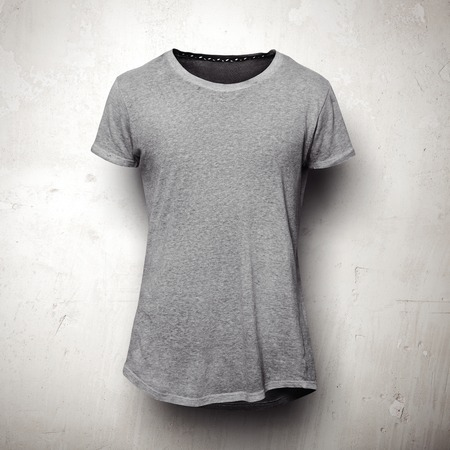 Grey t-shirt isolated on concrete grey wall Stock Photo