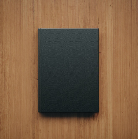 white space: Mock up of blank black book on the wooden table