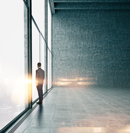 office buildings: Business man in suit looking at sunrise in the city.