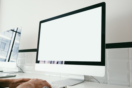 Mock up of generic design computer and workspace with man hands. Stock Photo