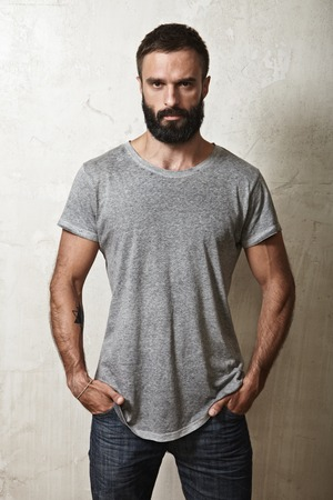 beard man: Portrait of a bearded guy wearing blank t-shirt Stock Photo