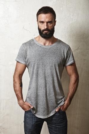 Portrait of a bearded guy wearing blank t-shirt Stockfoto