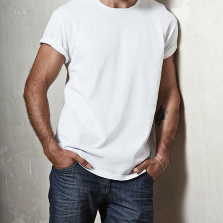 Close-up of a muscular man wearing blank t-shirt