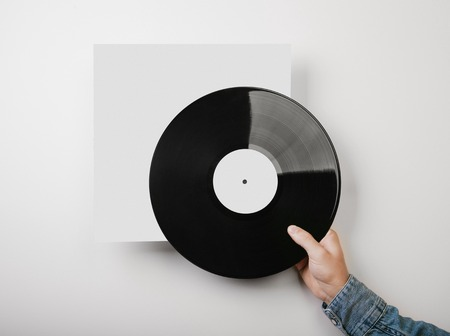 Template of vinyl cover on white wall background