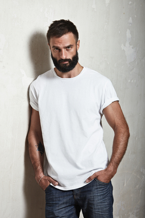 tshirts: Portrait of a bearded guy wearing blank t-shirt Stock Photo