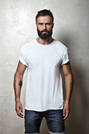 Portrait of a bearded guy wearing blank t-shirt Фото со стока