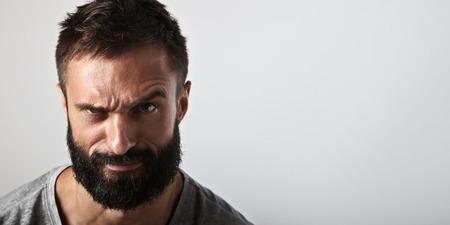 a beard: Close-up portrait of a handsome bearded man