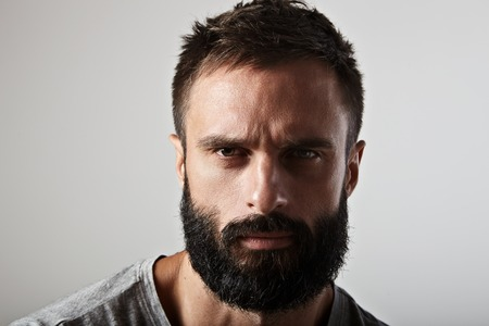 and the horizontal man: Close-up portrait of a handsome bearded man