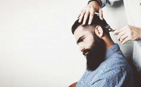 barber background: Mockup of bearded hipster in a barber shop