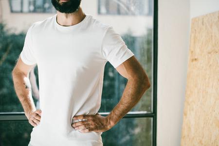 tshirt: Mockup of a handsome bearded man wering white tshirt